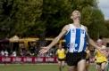 Matthew Bateman wins the womens and veteran's 1600m handicap final