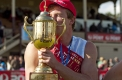 Sweet win: Matthew Wiltshire from Ballarat gets aquainted with his trophy after winning the Gift.