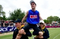 Gift winner Andrew Robinson from Tasmania is chaired around Central Park after his win.