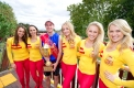 Lucky man: Gift winner Andrew Robinson gets lucky with the XXXX Gold girls at Central Park.