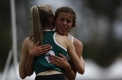 Girls (under 17) 100m final. Tiana Shillito hugs Jess Lehmann after the race.
